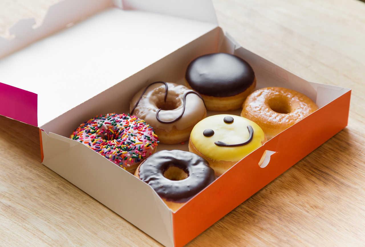 half dozen Dunkin donuts in a box